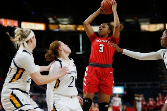Marist's Alana Gilmer pulls up for a shot against Quinnipiac at the Times Union Center in Albany on March 11.