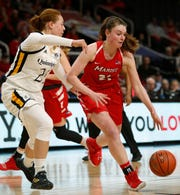 Marist's Willow Duffell drives against Quinnipiac's Jen Fay during the 2019 MAAC championship game in Albany.