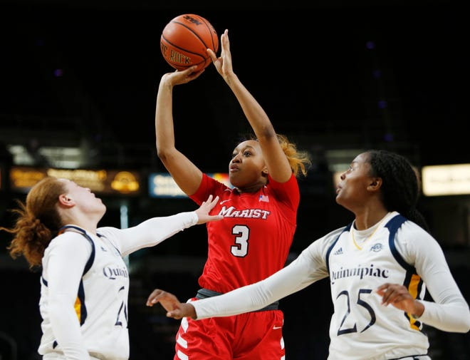 Marist's Alana Gilmer takes a shot between Quinnipiac's, from left, Jen Fay and Aryn McClure during the MAAC championship in Albany on March 11 2019.