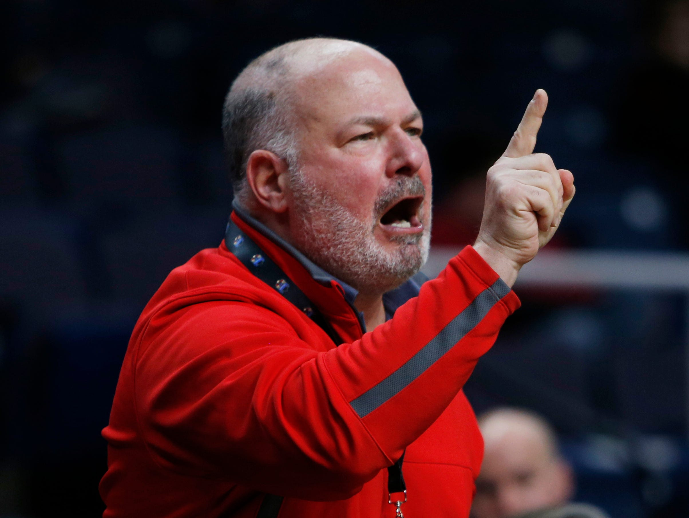 Marist College's president David Yellen disagrees with a call from one of the referees during the MAAC championship versus Quinnipiac in Albany on March 11 2019.