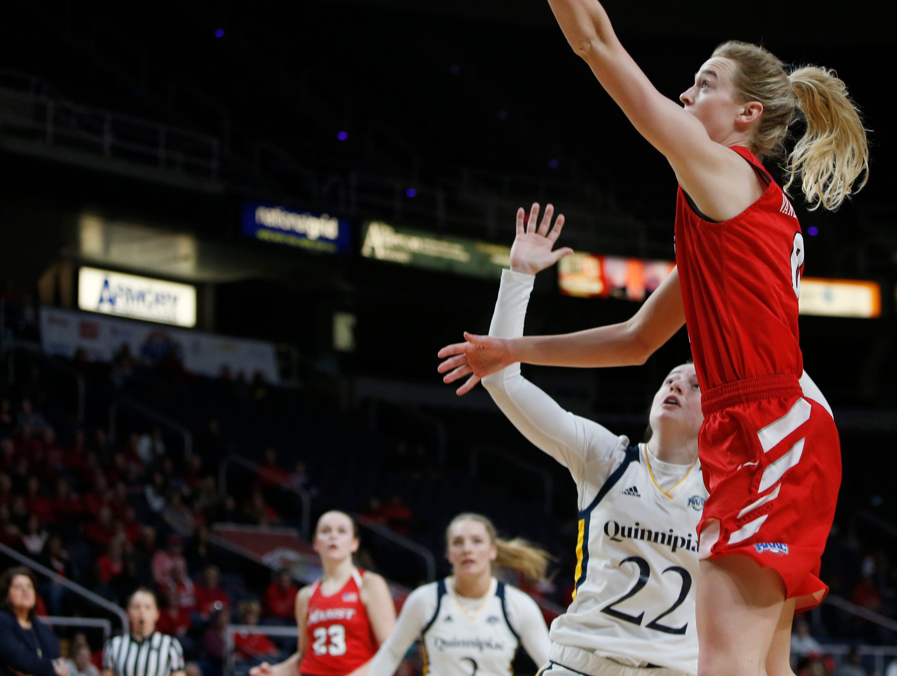Marist's Grace Vander Weide goes for a layup over Quinnipiac's Mackenzie DeWees during the MAAC championship in Albany on March 11 2019.