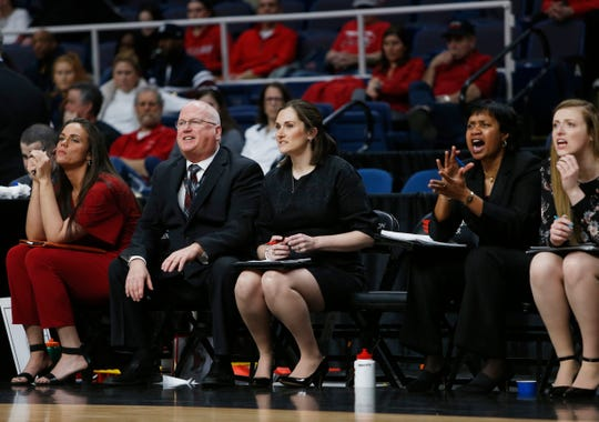 Marist's coaching staff looks on during the 2019 MAAC final.