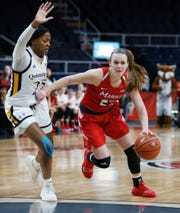 Marist's Rebekah Hand drives through goes Quinnipiac's Aryn McClure during the MAAC championship in Albany on March 11 2019.