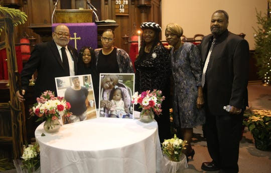 Those who knew Shanate, including Max Faircloth (right) and Ruth Faircloth (left) and Michele Melara (middle left) come together to pose for a photo at her funeral in early December.