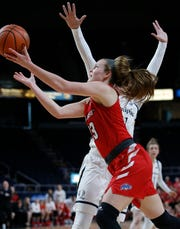 Marist College's Rebekah Hand stretches out for a layup against Quinnipiac on Monday in Albany.