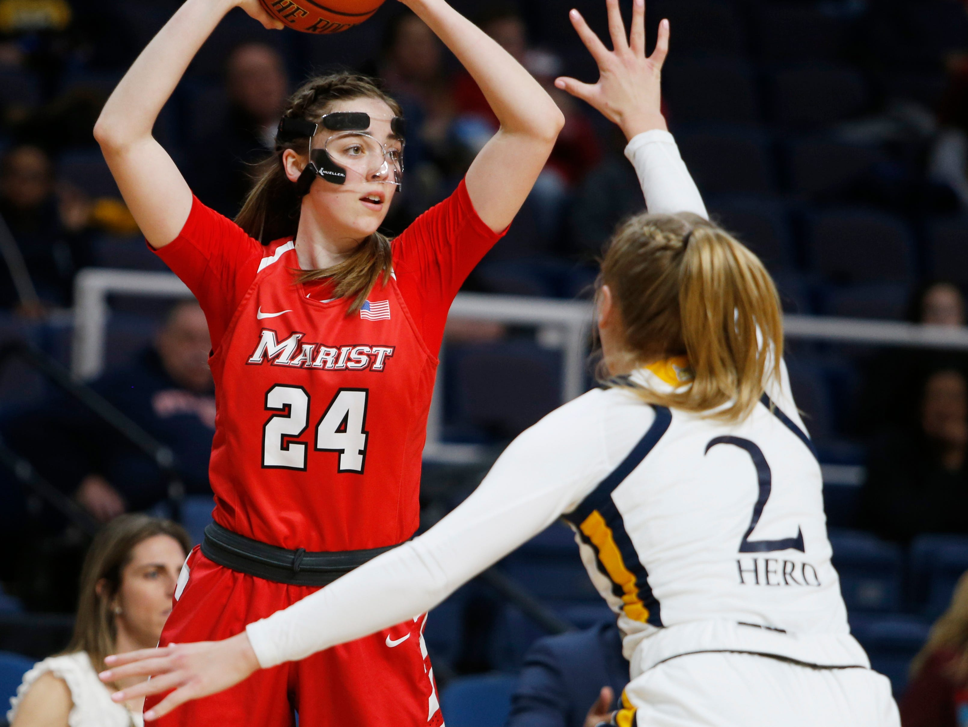 Marist's Sarah Barcello looks to pass the ball away from Quinnipiac's Taylor Herd during the MAAC championship in Albany on March 11 2019.