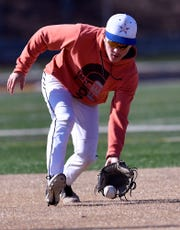Red Lion High School shortstop Cole Daugherty scoops up a grounder during practice, Monday, March 11, 2019