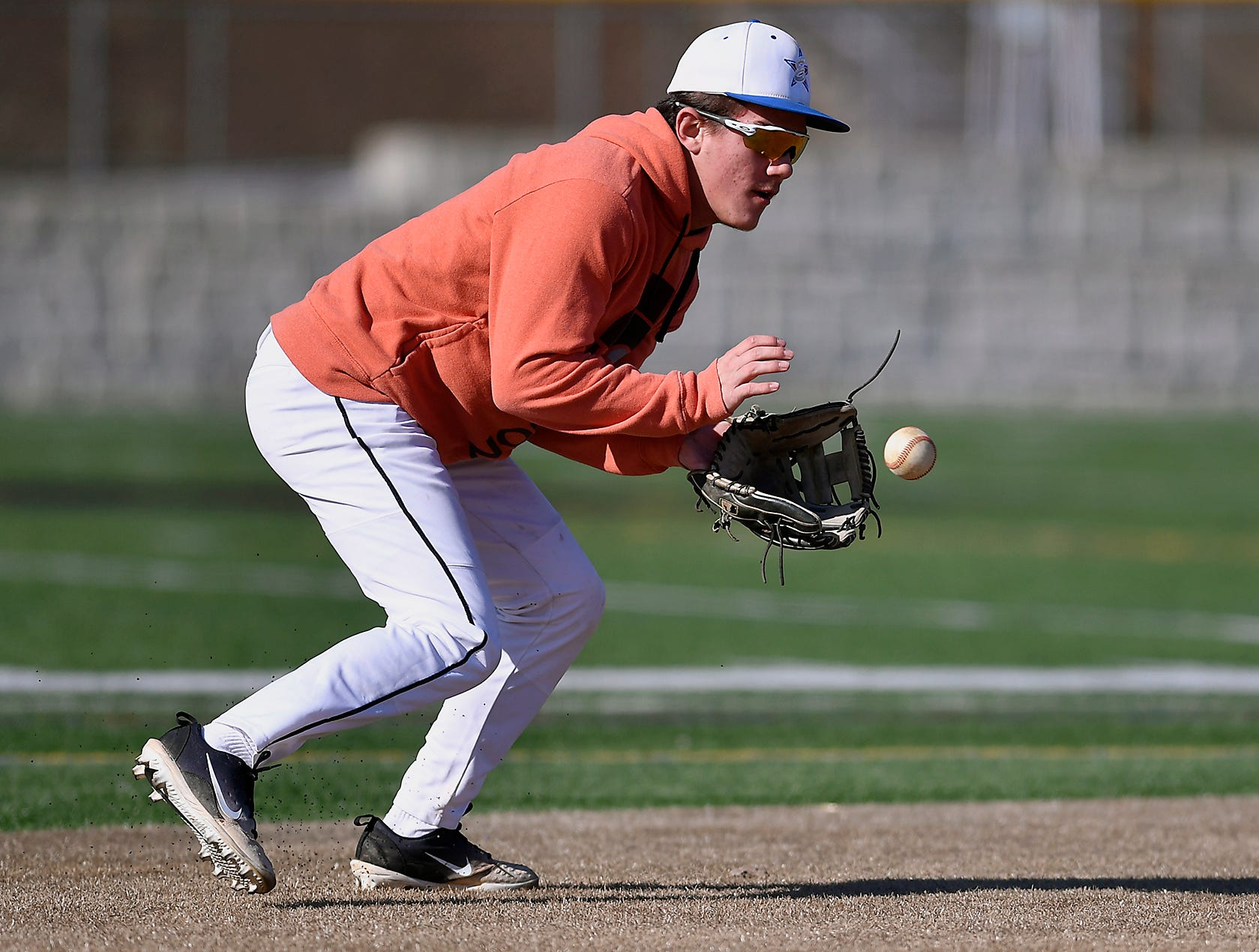 Red Lion High School shortstop Cole Daugherty scoops up a grounder during practice, Monday, March 11, 2019John A. Pavoncello photo