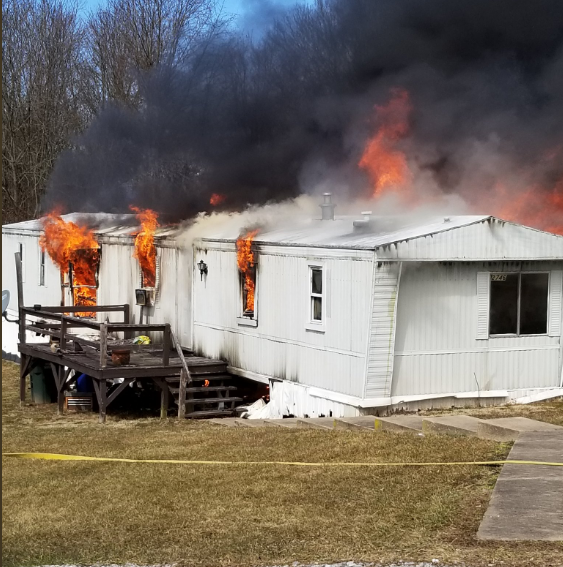 Firefighters, police respond as flames shoot from trailer in Dover Township