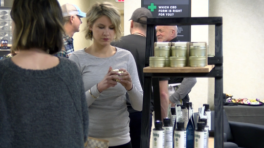 Guests check out hemp-based candles at the soft opening of Farmacy Partners located on S Queen Street in York by the ACCO Business Park. Farmacy specializes in hemp-based food and health products.