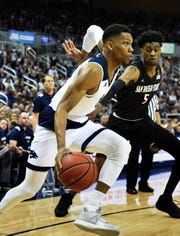 Nevada's Tre'Shawn Thruman drives against San Diego State's Jalen McDaniels at Lawlor Events Center on March 9, 2019.