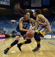 Nevada's Terae Briggs drives to the basket against Wyoming's Bailee Cotton on Feb. 16. Briggs has 14 points and seven rebounds in the Pack's loss to Boise State on Monday.