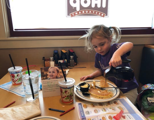 Naomi Bakker, 3, of Reno, anoints her pancakes with strawberry syrup at IHOP in South Reno. Bakker, who experienced severely delayed growth in utero, spent 142 days in Renown Children's Hospital, which receives donations raised through IHOP's Free Pancake Day (on March 12 in 2019).