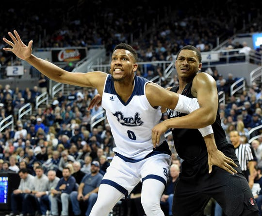 Nevada's Tre'Shawn Thurman looks to get the ball with San Diego State's Matt Mitchell covering him on Senior Night at Lawlor Events Center on Saturday.