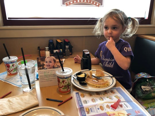 Lick! Syrup (especially strawberry syrup) is an essential part of the IHOP experience for Naomi Bakker, 3, of Reno, who received early medical care that saved her life from Renown Children's Hospital, one of the Children's Miracle Network hospitals supported by IHOP's Free Pancake Day, March 12, 2019.