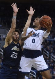 Nevada's Tre'Shawn Thurman (0) shoots while taking on Akron during their basketball game at Lawlor Events Center in Reno on Dec. 22, 2018.