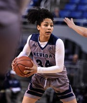 Nevada's Jade Redmon looks to pass the ball against Utah State on March 2. Redmon closed out her collegiate career with a career-high 25 points Monday.