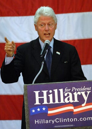 Former President Bill Clinton gestures during his speech at Richmond Firehouse No. 1 before an estimated crowd of 1,000 local residents on March 19, 2008.