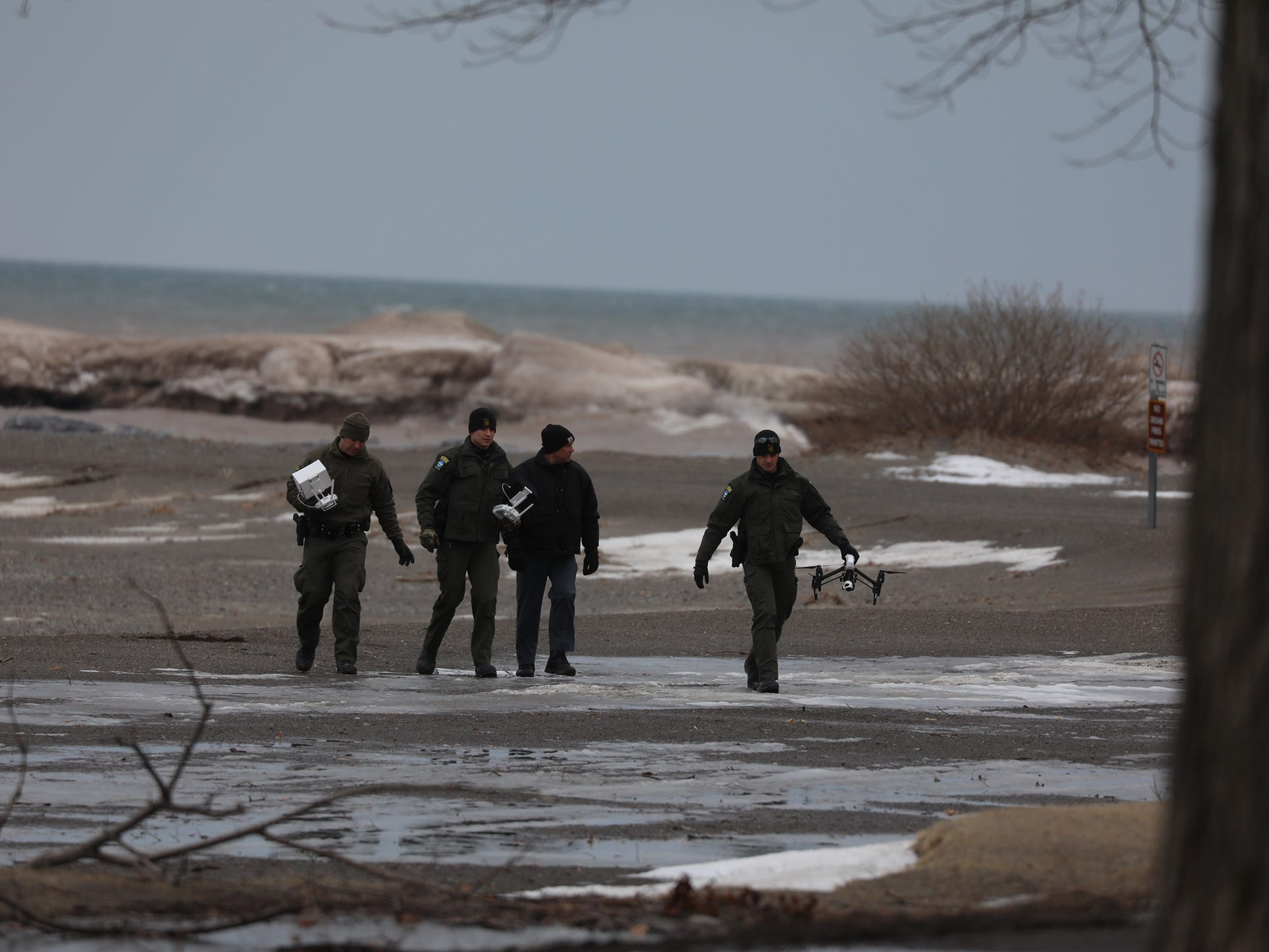 Forest rangers were using a drone to search the shoreline and nearby area.