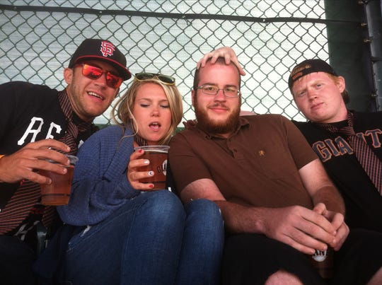 From left, Melvin Riffel, his wife, Brittney, Bennett Riffel and Mickenzie Wheeler at a San Francisco Giants baseball game. Melvin and Bennett Riffel are among the Ethiopian Airlines crash victims.
