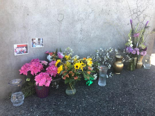 A memorial to Melvin and Bennett Riffel sits at the bell tower outside St. Joseph Catholic Church in Redding, where the Riffel family is members. Melvin and Bennett were among the 157 people killed when an Ethiopian Airlines jet crashed Sunday morning.