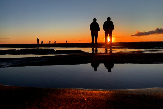 With another hour of daylight and spring-like weather, people gathered on the beach in Lincoln City, Oregon, to watch the first sunset during daylight saving time on March 10, 2019.