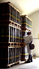 A chemical worker checks over projectiles containing sarin in a bunker at Umatilla Chemical Depot in 2001.