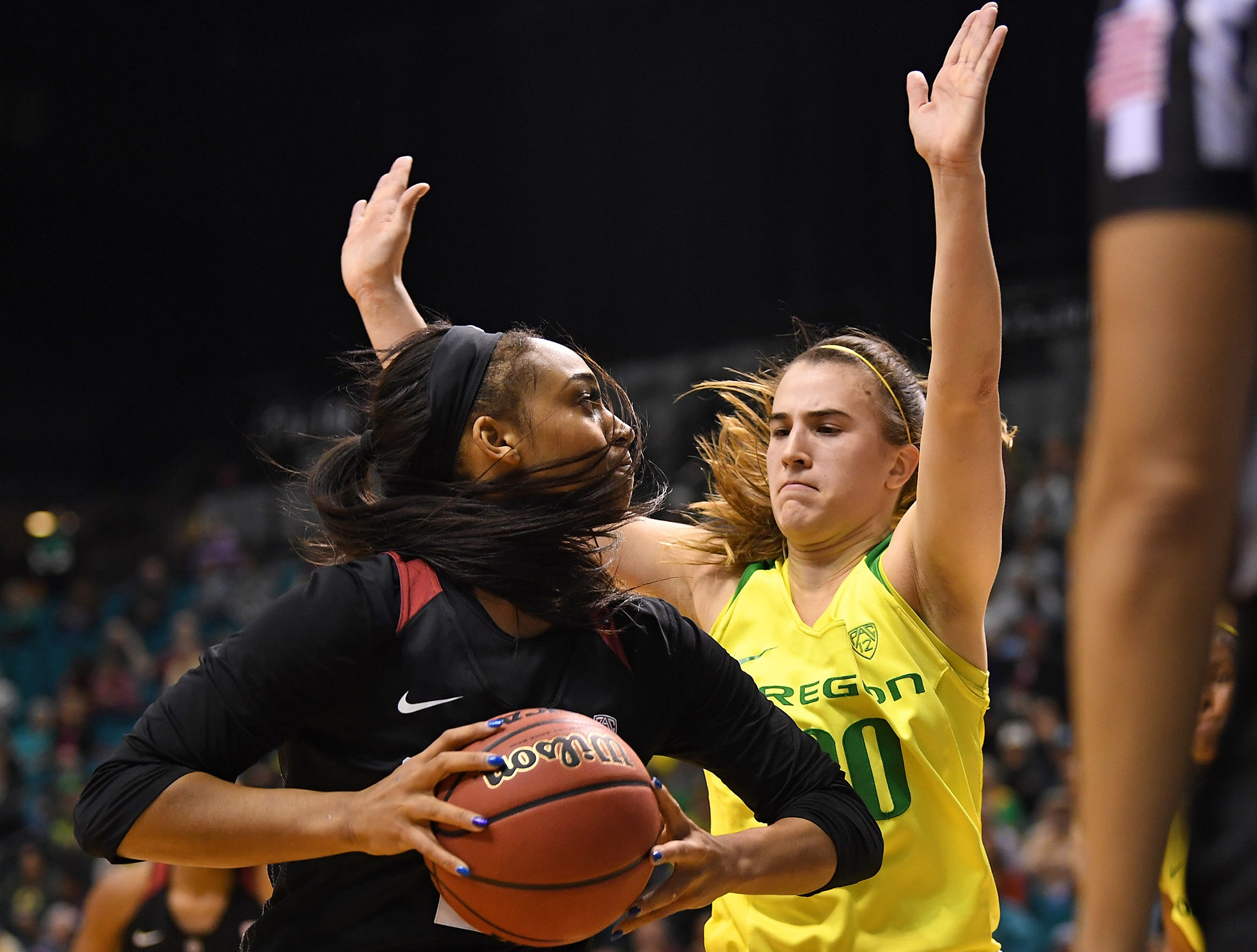 Stanford Cardinal guard DiJonai Carrington (21) drives against Oregon Ducks guard Sabrina Ionescu (20) during the second half of the women's Pac-12 Conference Tournament final at MGM Grand Garden Arena.