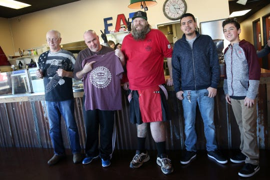 (From left to right) Kirk Brooks, Max Carnage (first place winner), Brian Mead, Ricky Duran and Omar Hernandez pose for a photo after the Goliath Burger challenge at Adam's Rib Smokehouse in Salem on Saturday, March 2, 2019.