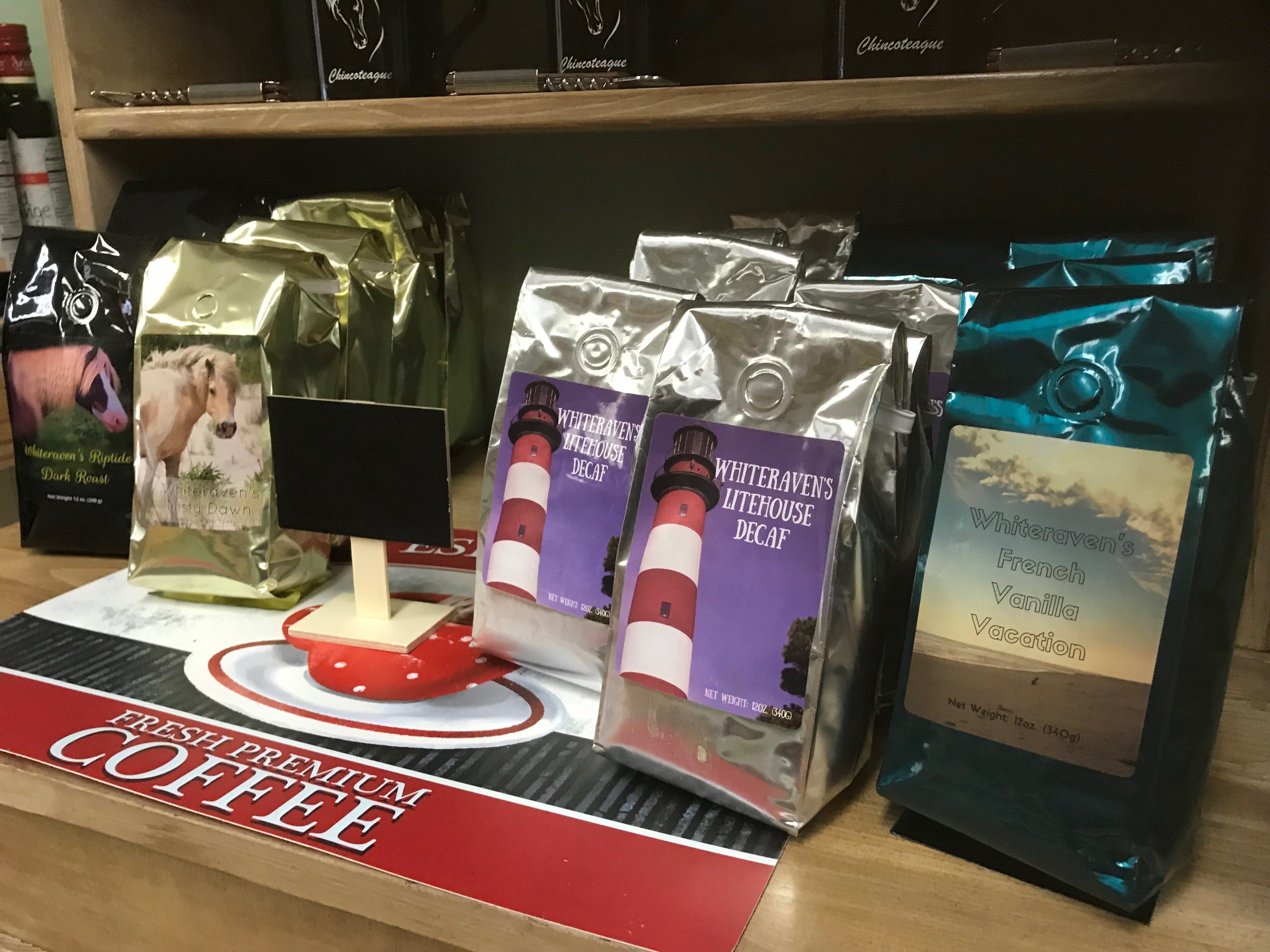 Coffees with  Chincoteague-related names sit on a shelf at Whiteraven's Nest Farm to Table store on Chincoteague Road in Wallops Island, Virginia on Friday, March 8, 2019.
