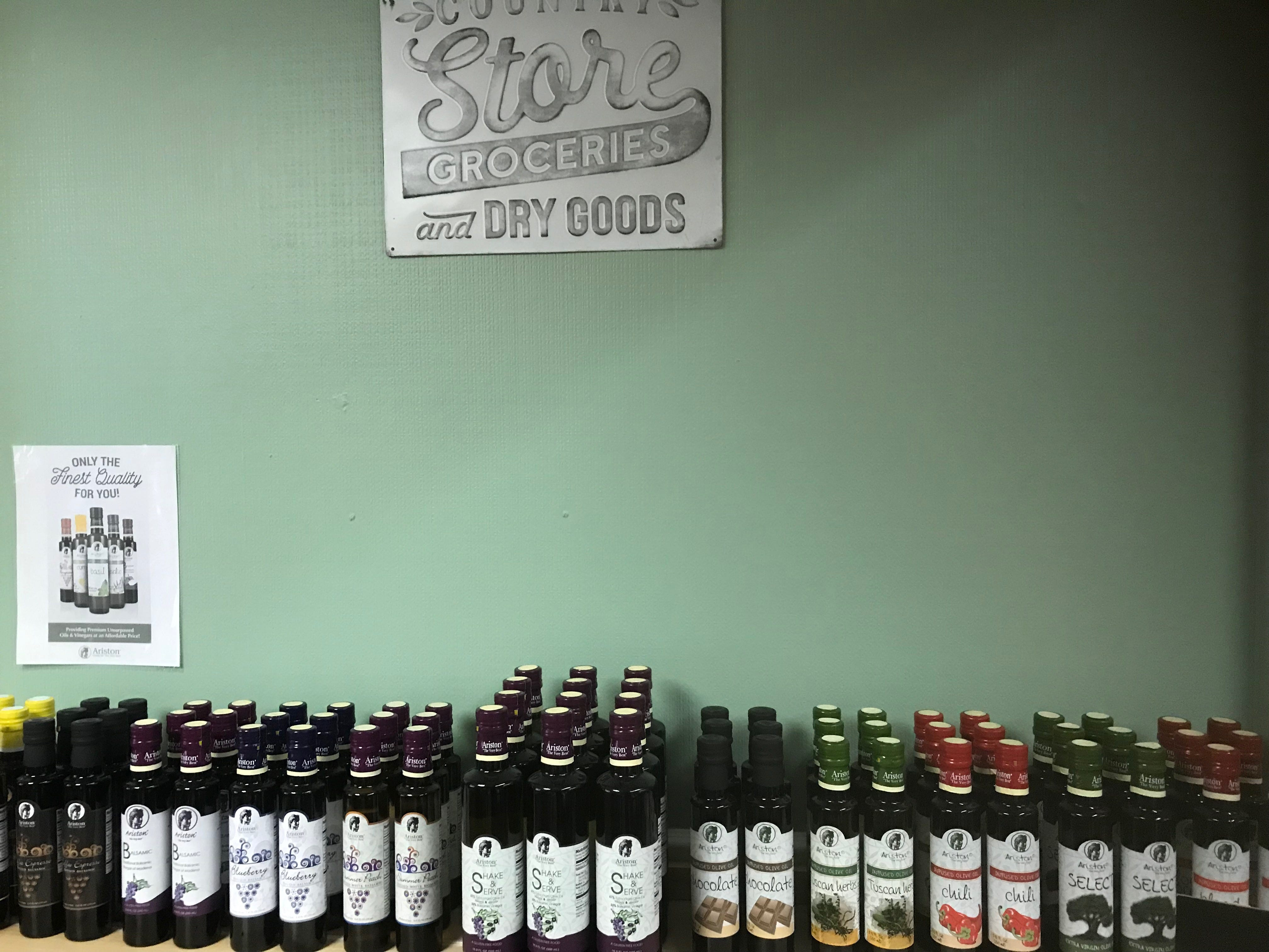 Bottles of gourmet olive oil and balsamic vinegar sit on a shelf in Whiteraven's Nest Farm to Table store on Chincoteague Road in Wallops Island, Virginia on Friday, March 8, 2019.