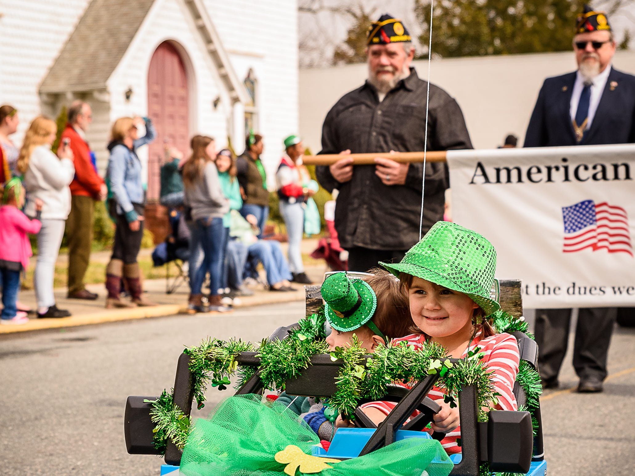 Two young parade participants take part in the Onancock parade in their decorated jeep.