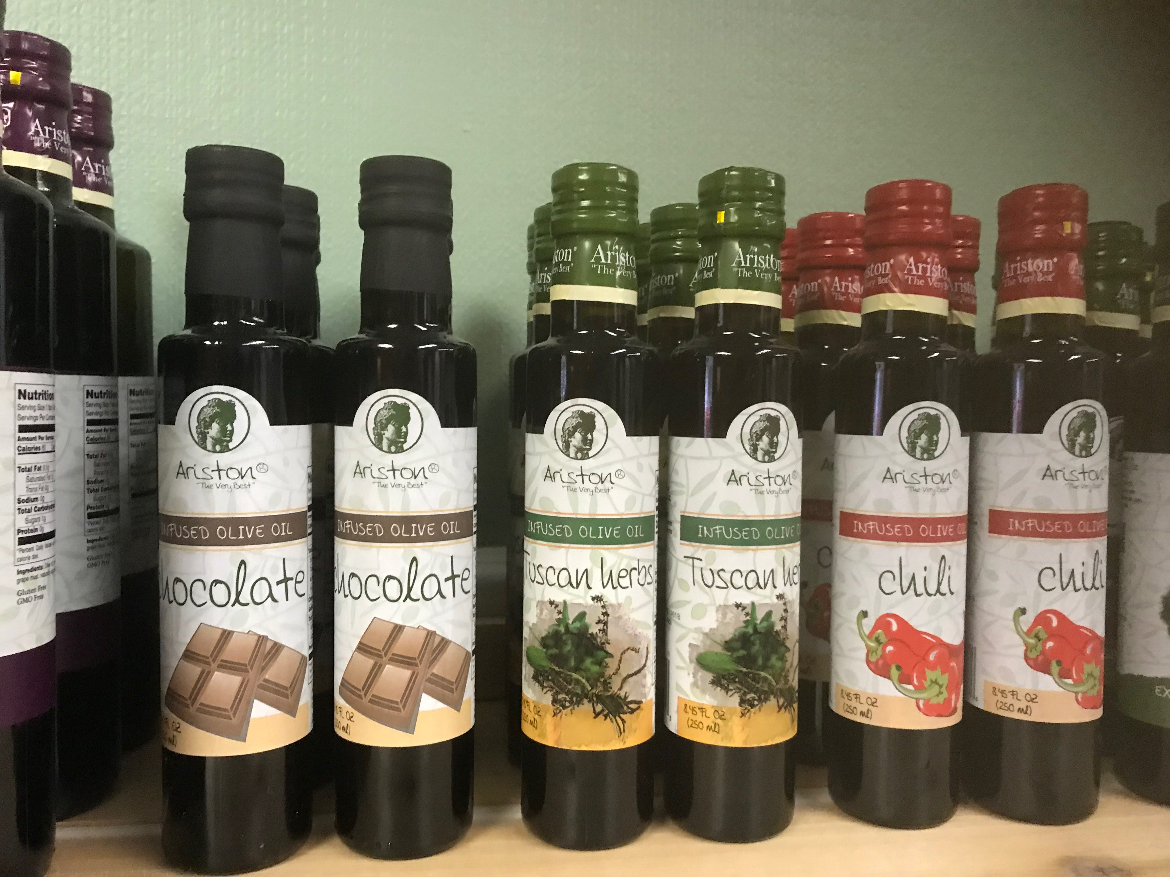 Bottles of gourmet olive oil sit on a shelf in Whiteraven's Nest Farm to Table store on Chincoteague Road in Wallops Island, Virginia on Friday, March 8, 2019.