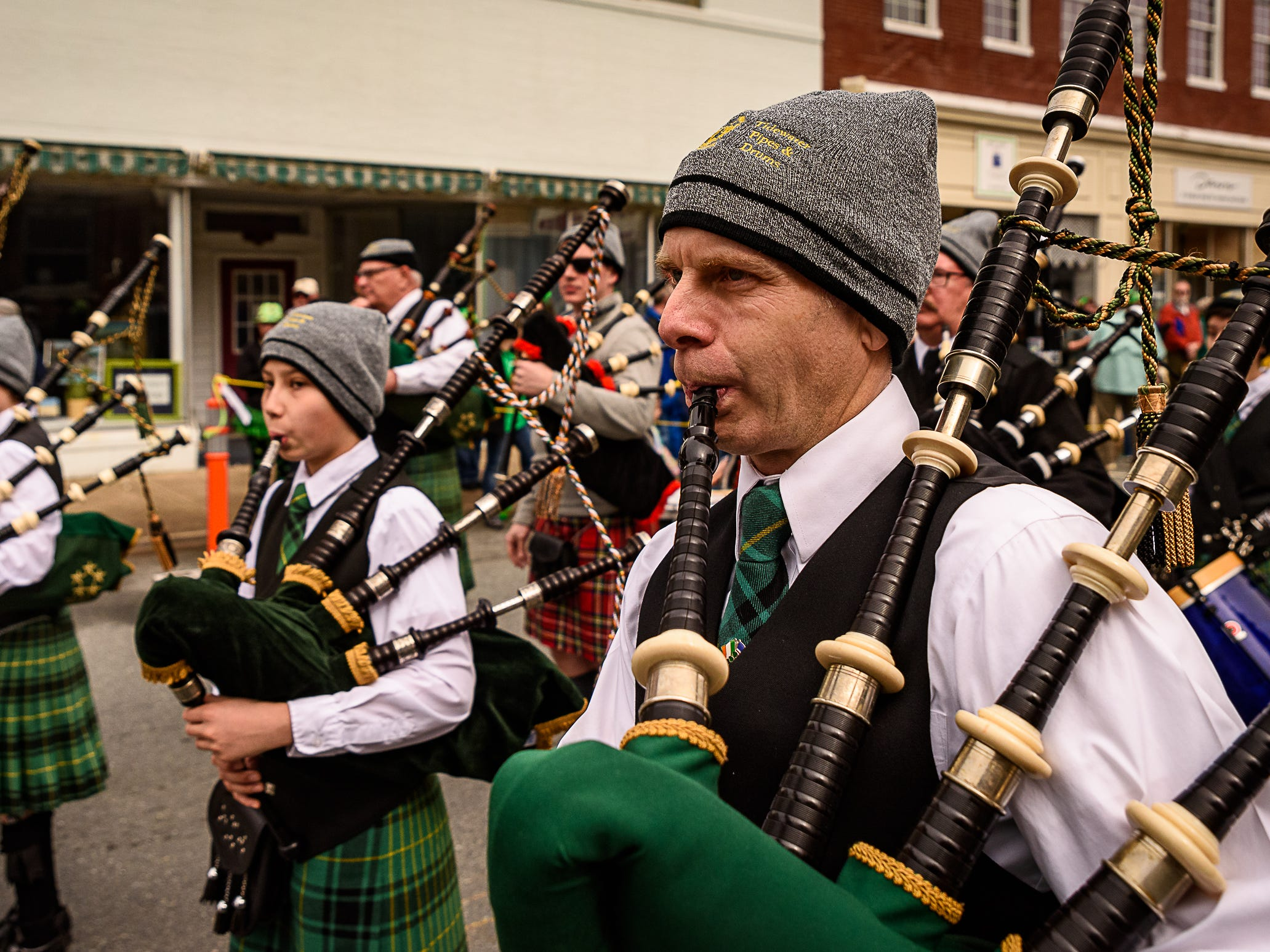 Members of the Tidewater Pipe and Drum Corp perform in Onancock's St. Patrick's parade.