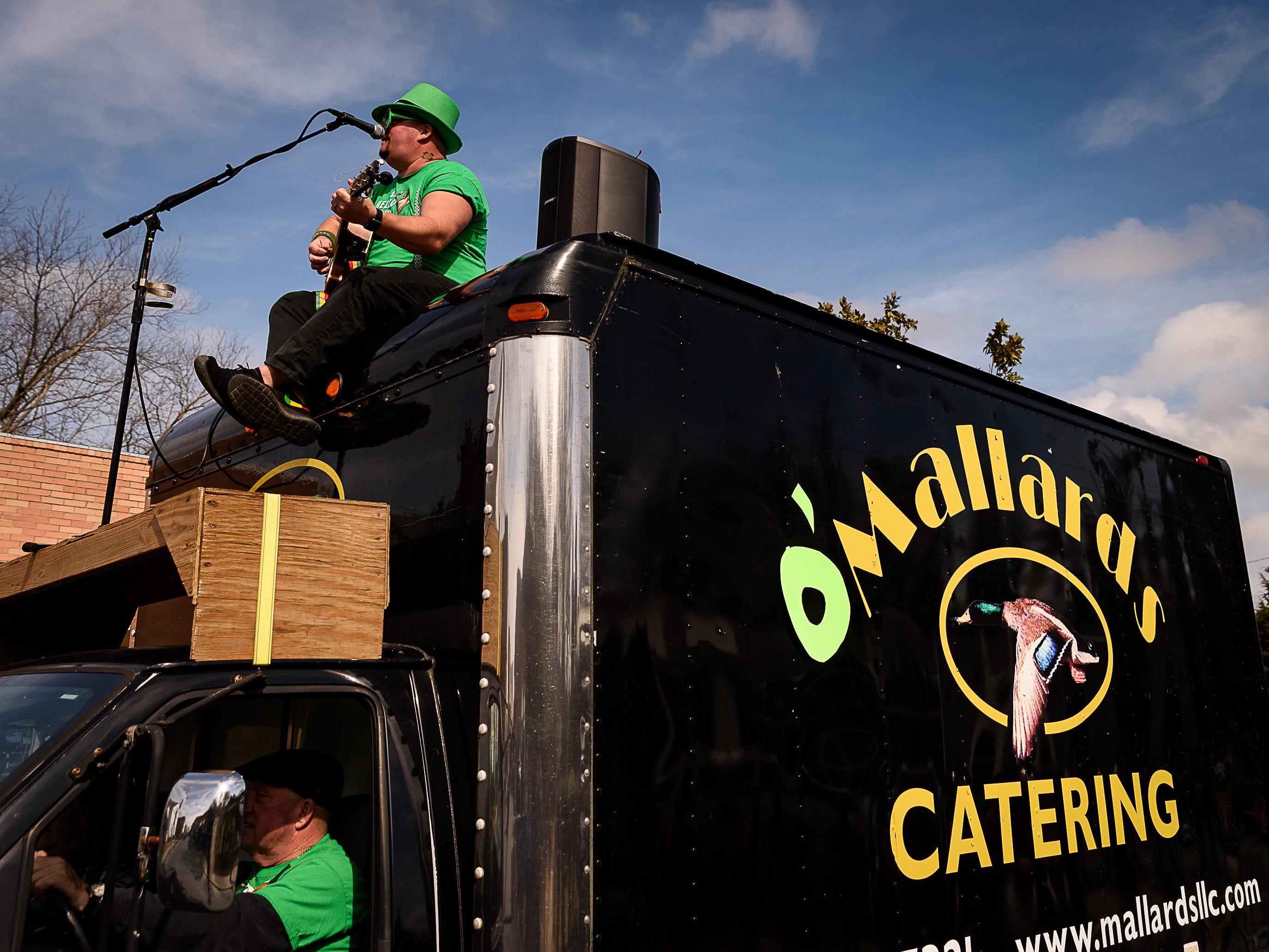 Johnny Mo. the musical chef, is perched atop the Mallards Restaurant Catering Truck as he performs in the Onancock parade.