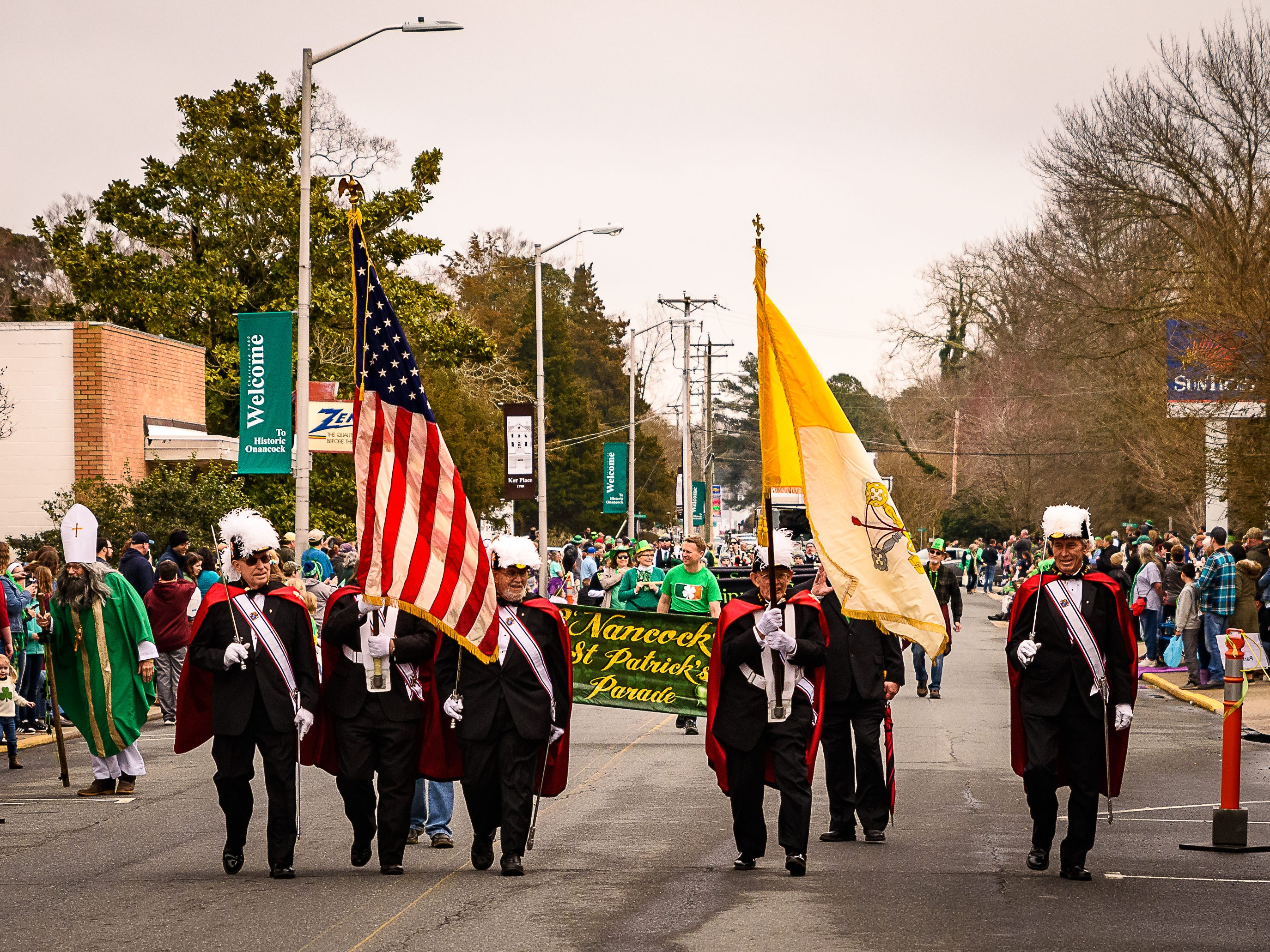 The color gaurd from The Knights Of Columbus leads off Onancock's St Patricks Day parade on Sunday, March 10, 2019.