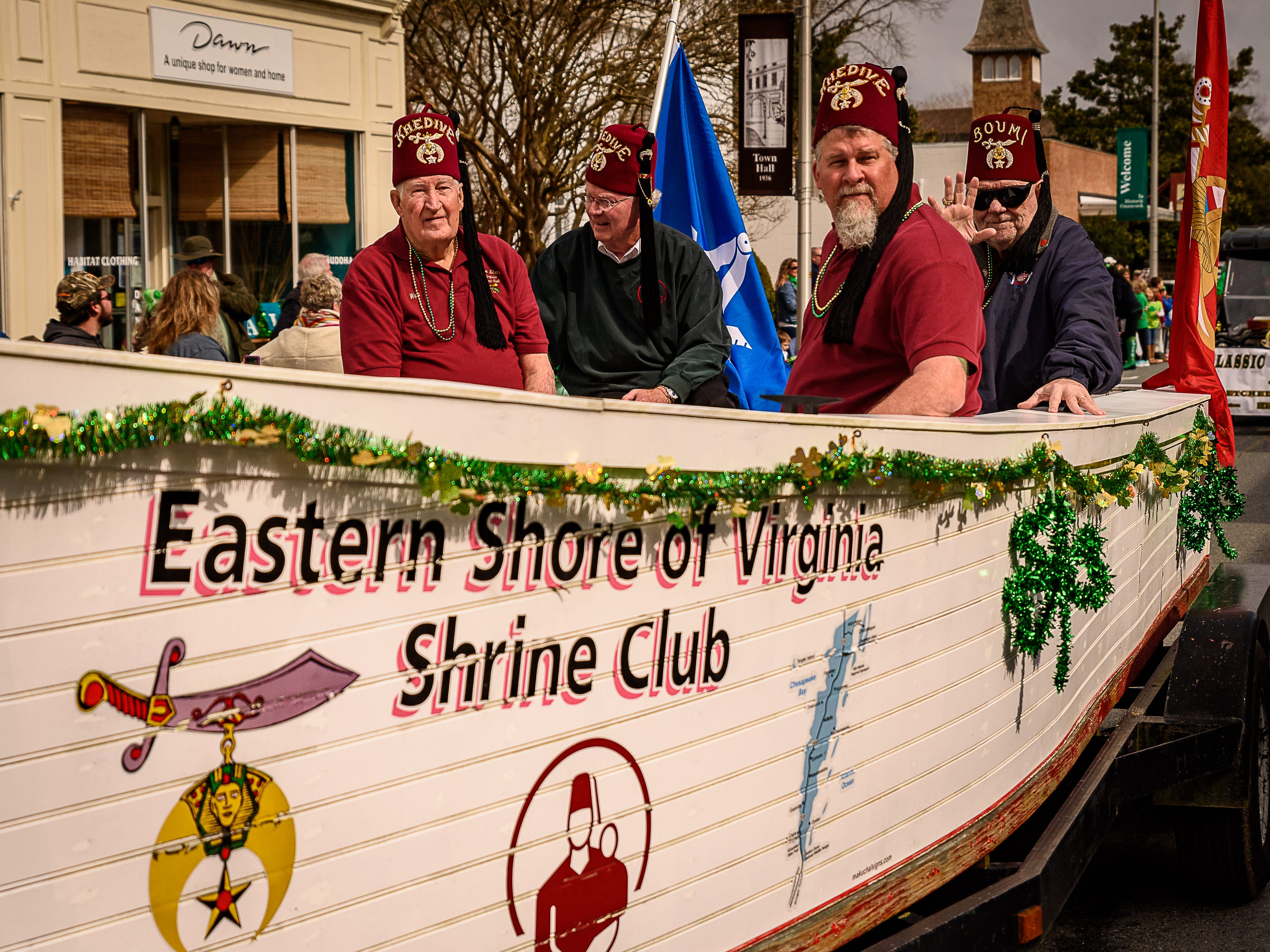 Members of The Eastern Shore Of Virginia Shrine Club took a boat along the parade route in Onancock.