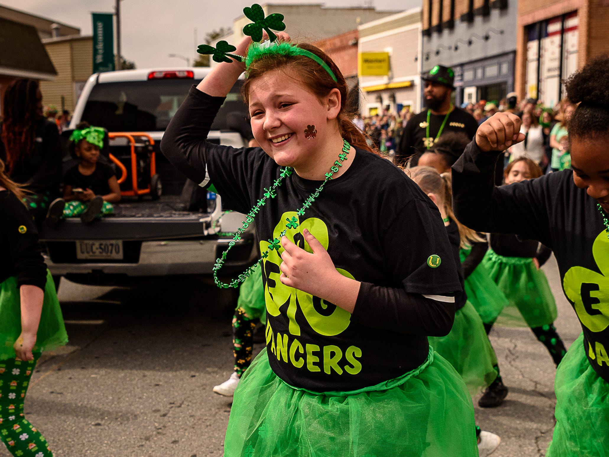 A member of the ESG Dancers performs for the judges and the crowd at Onancock's St. Patrick's parade on Sunday, March 10.
