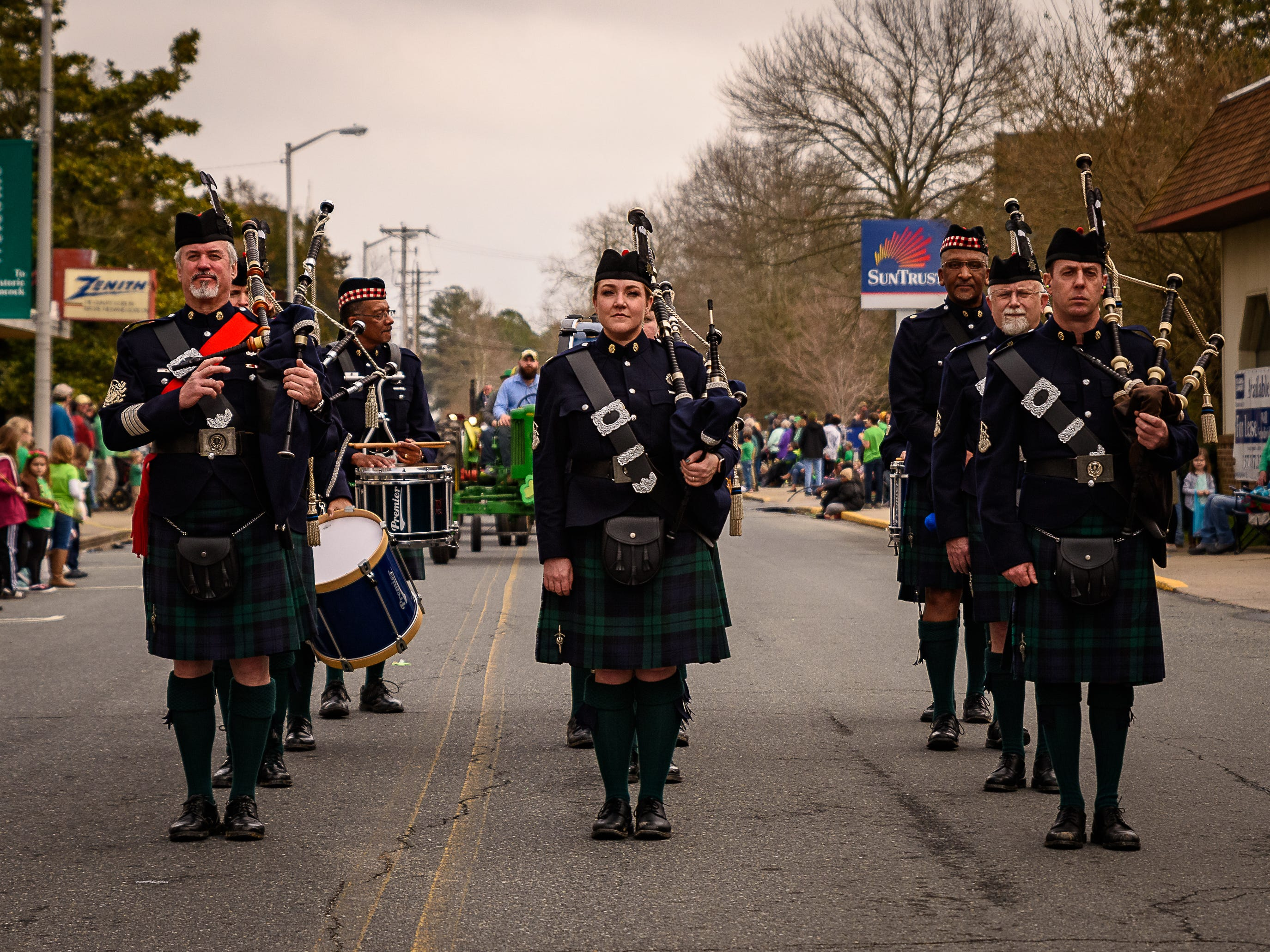 The Newport News Police Department Pipe and Drum Corp perform in the Onancock parade.