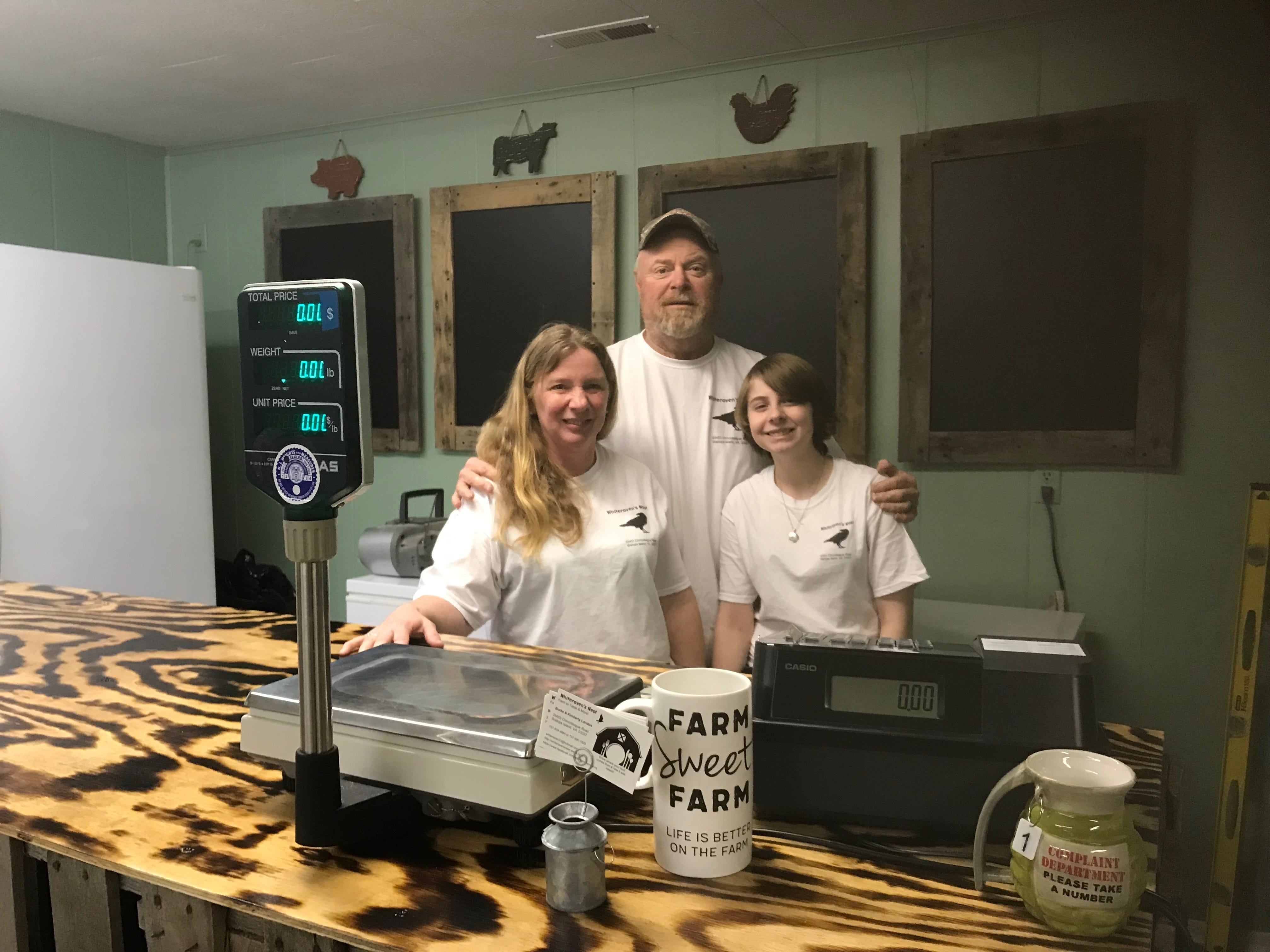 Kimberly and Burke Landon and daughter Selena stand behind the counter of their new farm-to-table store on Chincoteague Road in Wallops Island, Virginia on Friday, March 8, 2019.