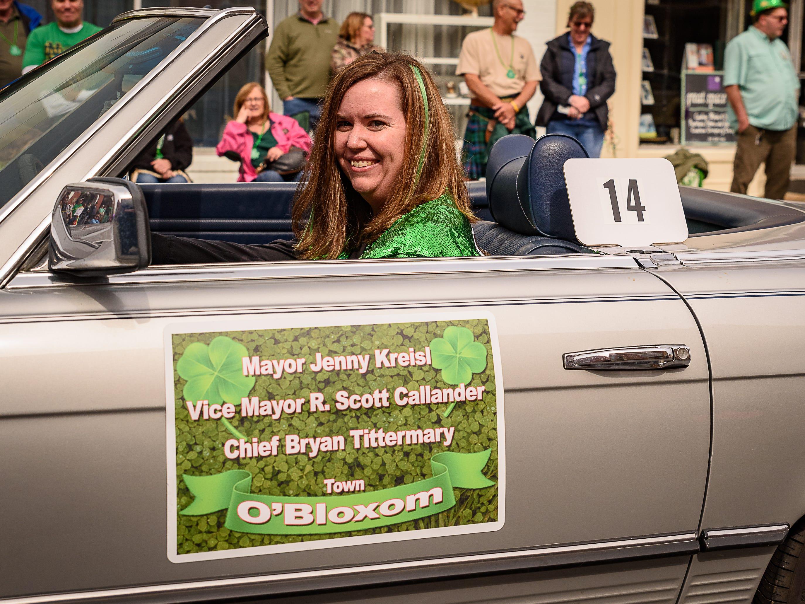 Bloxom Mayor Jenny Kreisl drives herself along the parade route in Onancock.