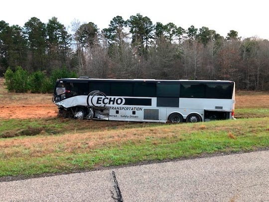 A bus is off the road after a fatal bus crash in Tyler, Texas, Sunday, March 10, 2019. Police say multiple people died after their pickup truck collided in East Texas with a charter bus carrying students returning from a trip to Florida. (Tyler Police via AP)