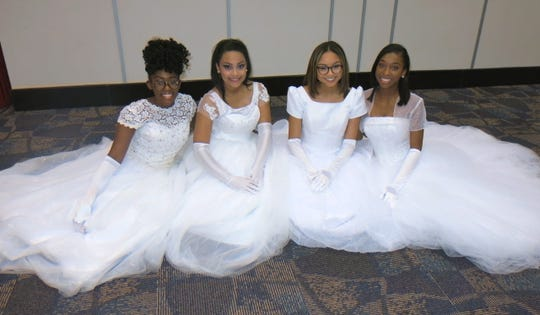 Alpha Kappa Alpha Debs take time for a photo op before their debut: Gianna Bonyfield, Camryn Ray, Colbi Washington, Camille Broudy.