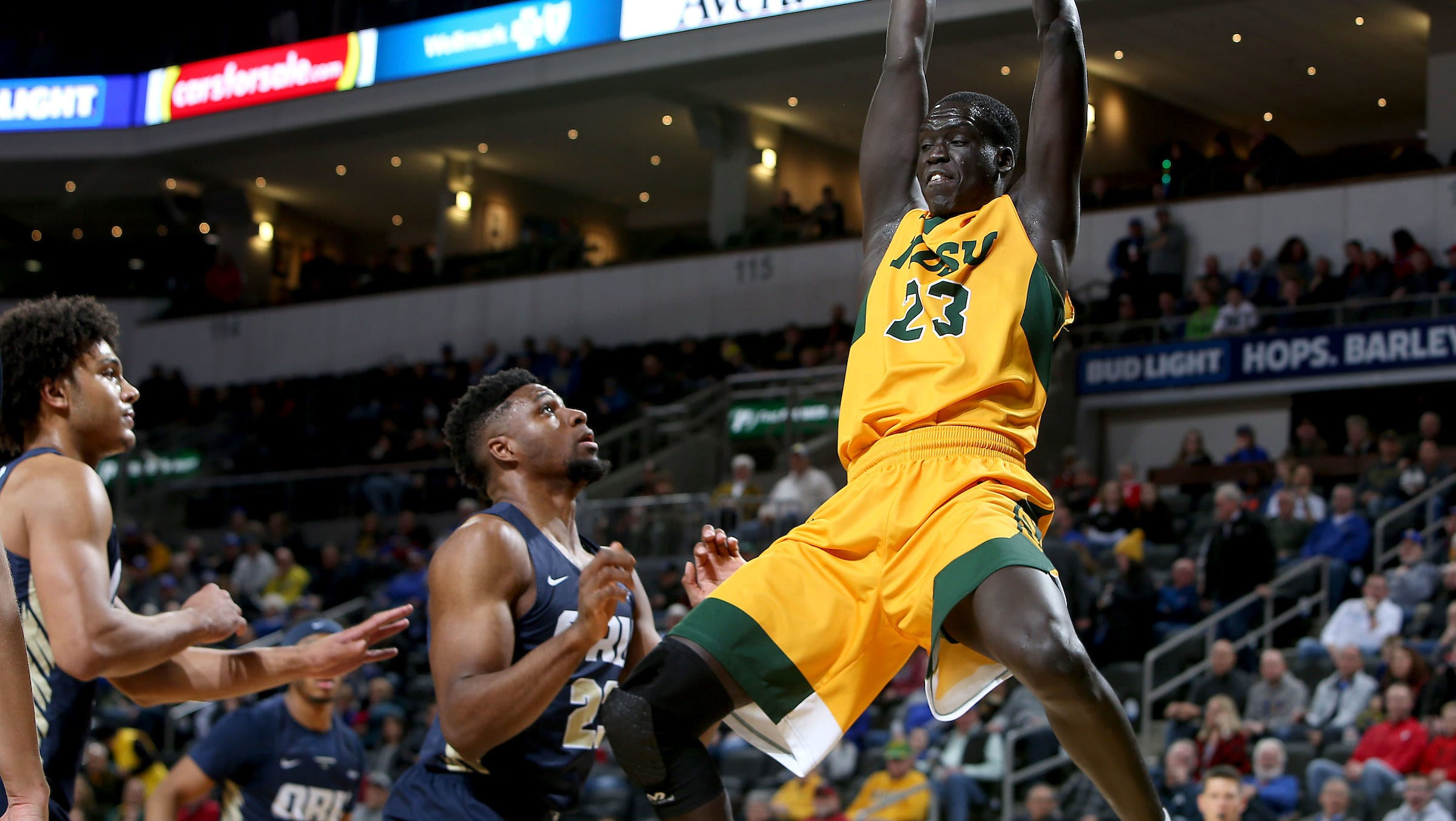 SIOUX FALLS, SD - MARCH 10: Deng Geu #23 from North Dakota State throws down a dunk above Emmanuel Nzekwesi #23 from Oral Roberts at the 2019 Summit League Basketball Tournament at the Denny Sanford Premier Center in Sioux Falls. (Photo by Dave Eggen/Inertia)