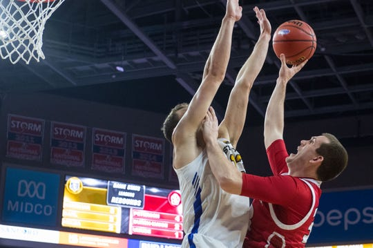 USD's Logan Power (33) shoots the ball over Purdue Fort Wayne player during the game at the 2019 Summit League Basketball Tournament at the Denny Sanford Premier Center  in Sioux Falls, S.D., Sunday, March 10, 2019.