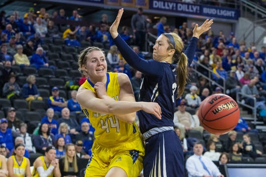 SDSU's Myah Selland (44) passes the ball during the game against Oral Roberts at the 2019 Summit League Basketball Tournament at the Denny Sanford Premier Center  in Sioux Falls, S.D., Monday, March 11, 2019.