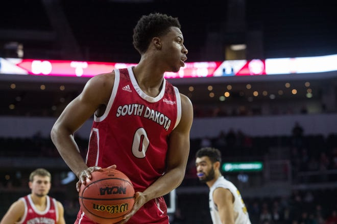 USD's Stanley Umude (0) looks to pass the ball during the game against Purdue Fort Wayne at the 2019 Summit League Basketball Tournament at the Denny Sanford Premier Center  in Sioux Falls, S.D., Sunday, March 10, 2019.