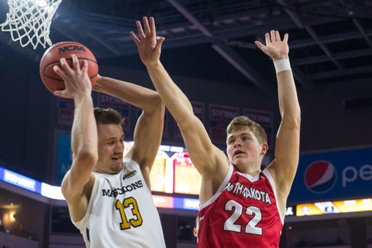 USD's Tyler Peterson (22) blocks Purdue Fort Wayne's  Matt Holba (13) during the game at the 2019 Summit League Basketball Tournament at the Denny Sanford Premier Center  in Sioux Falls, S.D., Sunday, March 10, 2019.