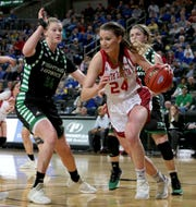 SIOUX FALLS, SD - MARCH 11: Ciara Duffy #24 from South Dakota dribbles past Lexi Klabo #34 of North Dakota at the 2019 Summit League Basketball Tournament at the Denny Sanford Premier Center in Sioux Falls. (Photo by Dave Eggen/Inertia)