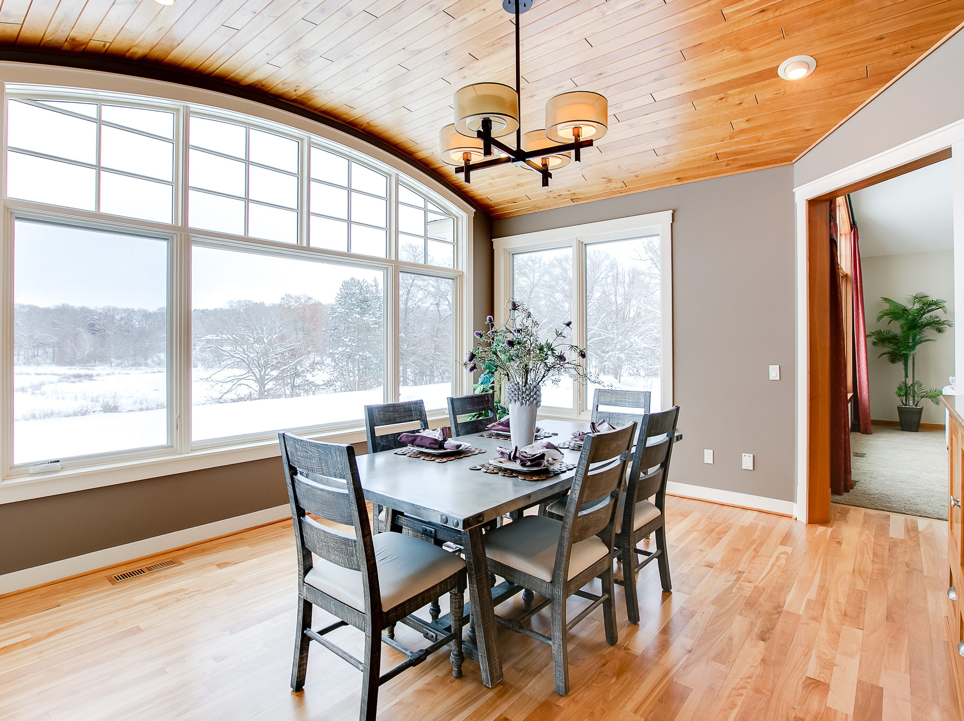 The dining room overlooks the backyard nature-scape and is large enough to accommodate big groups for holidays and gatherings.